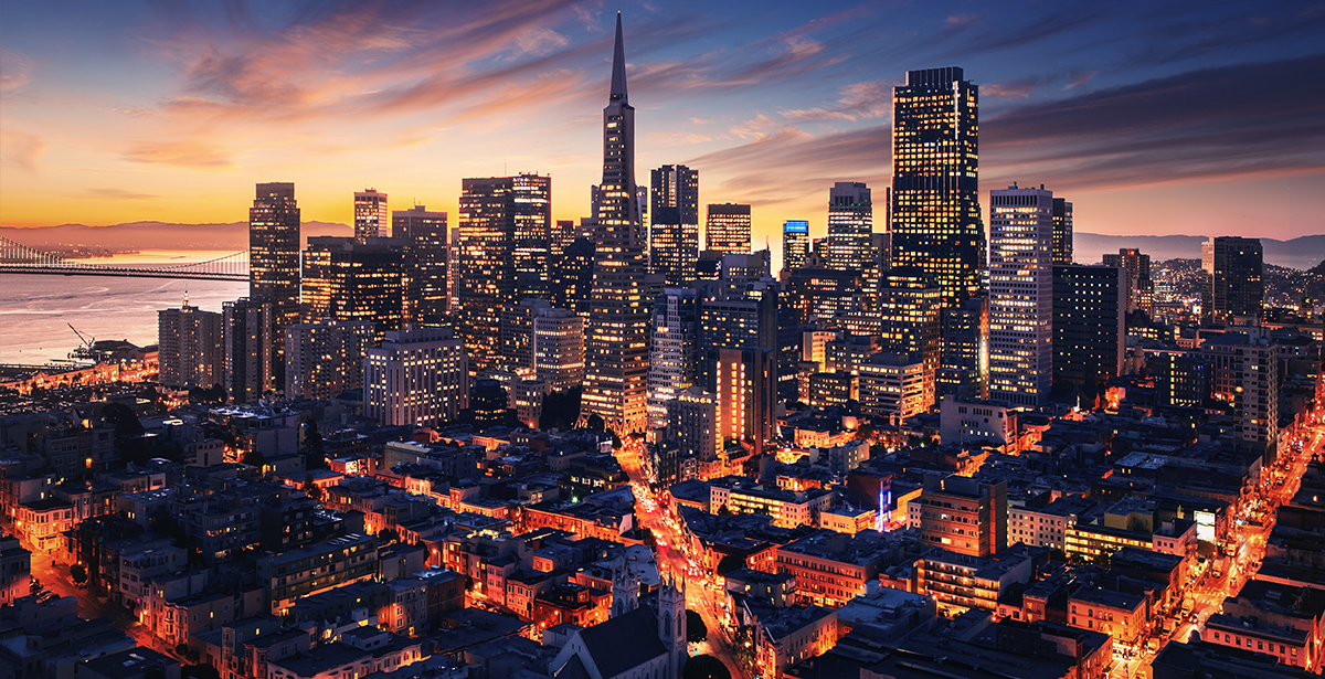 An aerial view of downtown San Francisco at sunset.
