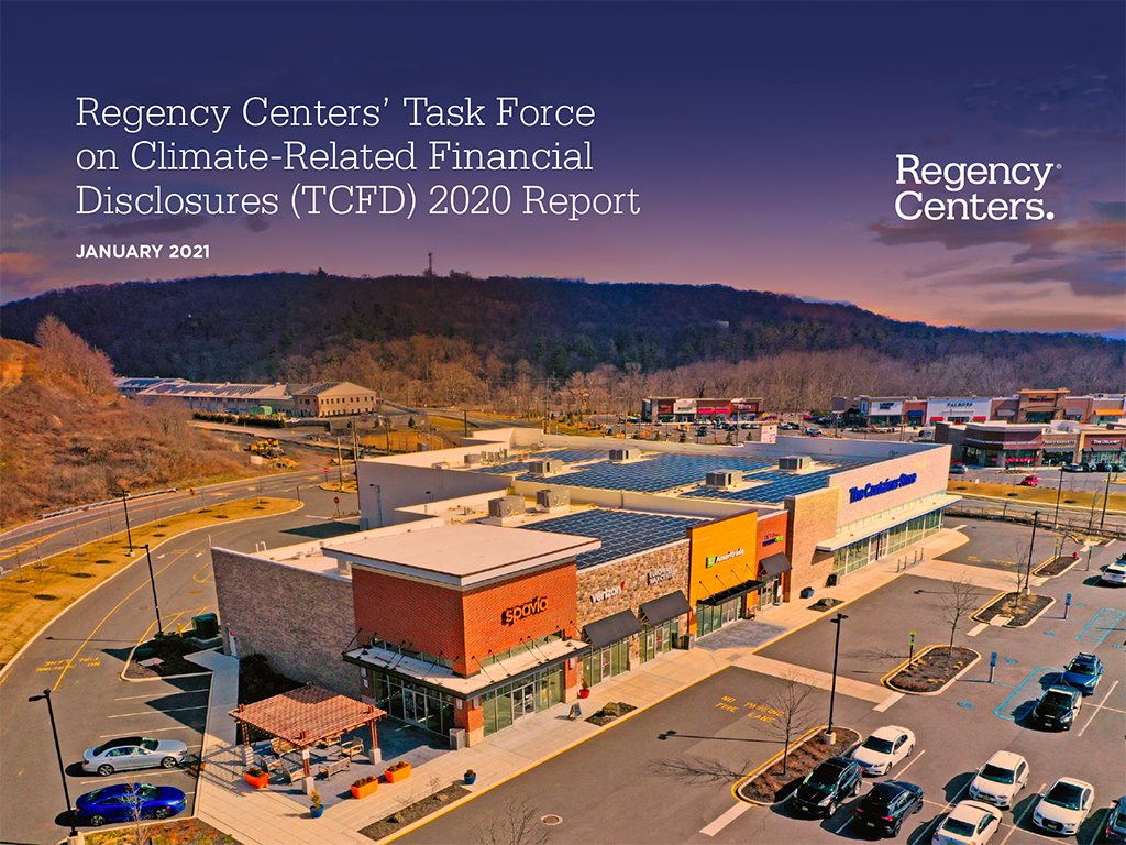 """Cover image for Regency's 2020 TCFD Report including title """"Task Force on Climate-Related Financial Disclosures,"""" January 2020, and the Regency Centers logo. The background is an aerial view of a Regency Center near mountains under a purple sunset."""