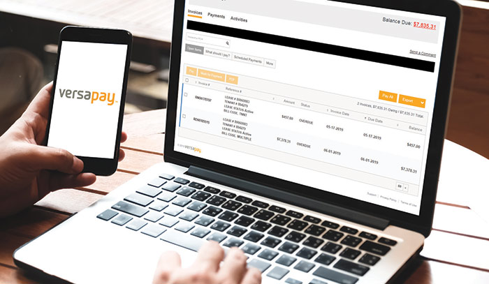 Tenant paying rent online using VersaPay on their phone and laptop