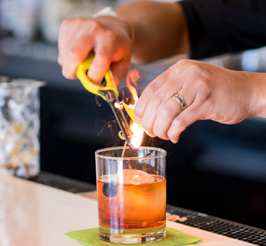 Bartender Making a Cocktail With Fire